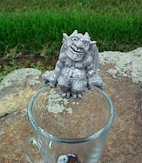 Gargoyle mug hugger on rock